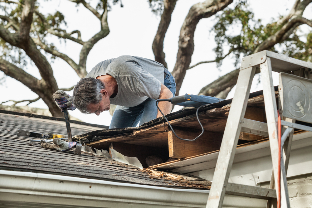 man doing roof replacement
